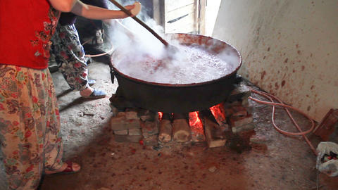 Traditional making tomato paste in boiler with wood fire in the village Footage