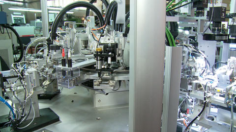 Advanced industrial production line for small parts, robotic arms working Live Action