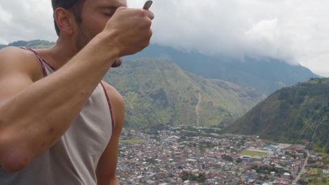 Tourist Enjoying His Meal While Watching The Landscape In Ecuador Live Action