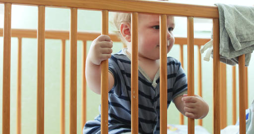 Child is entertained in the crib Live Action