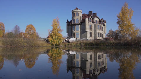 Big wonderful mansion with nice pond in front of it located in country side Live Action