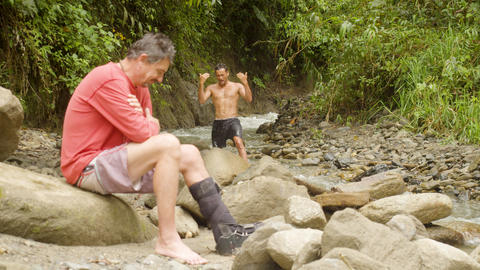 Man Inviting His Friend To Bathe In The River In Ecuador Footage