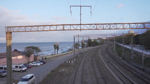 Camera slowly moving showing old metallic bridge over railways on sunny day Live Action