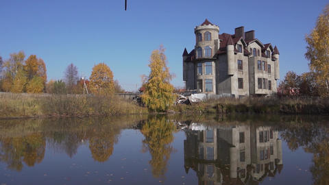 Nice grand rural estate with nice pond in front of it located in country side Live Action