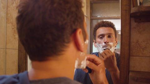 Man Shaving His Beard In The Bathroom In Ecuador Live Action