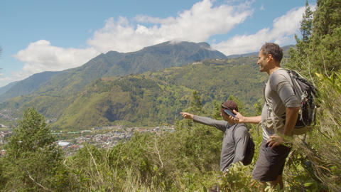 Tourists Pointing Out A Place Of Interest In The Landscape In Ecuador Live Action