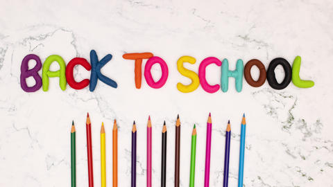Back to school stop motion animation with moving colored pencils Animation