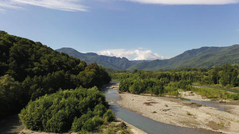 Aerial drone shot of a fast white alpine river. Beautiful view of mountain river Live Action