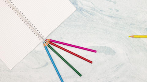Stop motion animation of school notebook and colored pencils and pens on blue background Animation