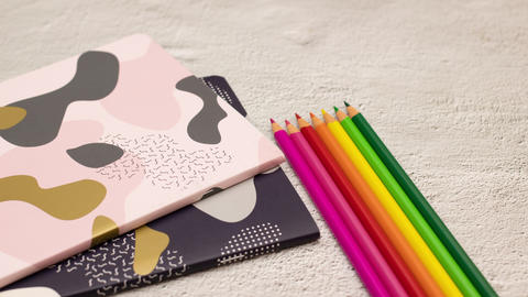 Stop motion animation of notebook and colored pencils appear and disappear Animation