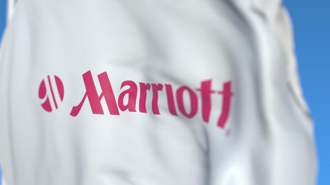 Flying flag with Marriott International logo, close-up. Editorial loopable 3D Live Action