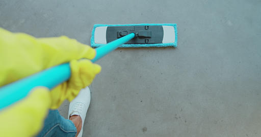 Cropped image of beautiful young woman in protective gloves using a flat wet-mop Footage