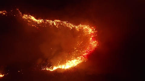 Aerial view. Dangerous fire in the field. Night fire, natural disaster Live Action