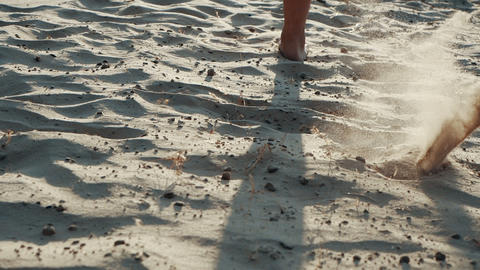 Rare view of a barefoot woman feet running on a sand beach in SLOW MOTION Live Action