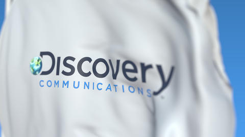 Flying flag with Discovery Communications logo, close-up. Editorial loopable 3D Footage