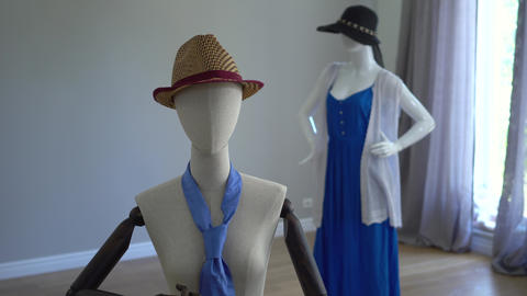 Female mannequins fitting on stylish clothing, accessories and apparels standing Live Action