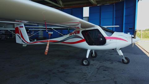 Light sport airplane in hangar, Pipistrel Virus 912, private propeller aircraft Live Action