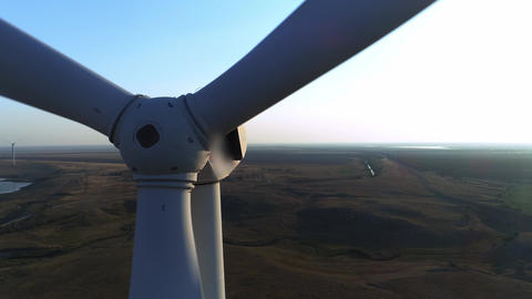Close up of a wind turbine. Aerial top view wind turbine, moving above the white Footage