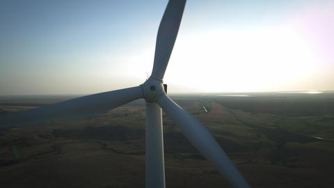 Close up of a wind turbine. Aerial top view wind turbine, moving above the white Live Action