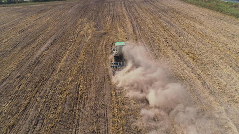 Tractor with disc harrows on the farmland Footage