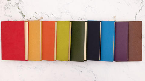 Stop motion animation of ordering books on white background, Stock Animation