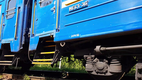 Blue train rides left at the foot of the Carpathian mountains Live Action