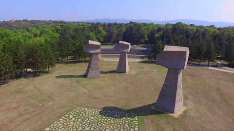 Aerial drone footage of Bubanj memorial park in Serbia with Three fists monument from the world war Live Action