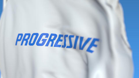 Waving flag with Progressive Corporation logo, close-up. Editorial loopable 3D Live Action