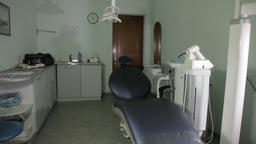 The dental chair, lamp and other equipment magically move themselves in the Footage