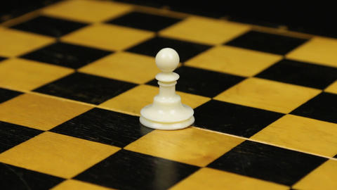 Rotation. Chess figure white pawn on chess board. Close-up Footage