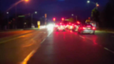 Approaching Red Light Intersection at Night in City With Blur Effect. Driver Point of View POV Live Action