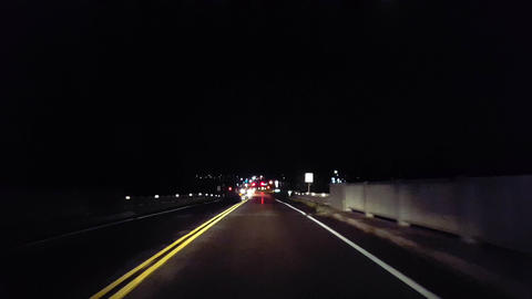 Driving Through Rural Countryside Approaching City Lights on Horizon. Driving Point of View POV Footage