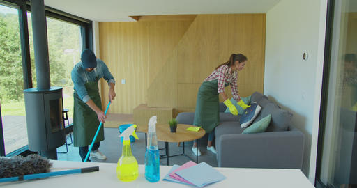 Positive smiling professional cleaners doing cleanup in ordinary apartment Footage