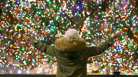 Happy girl on the background of the Rockefeller Christmas tree in New York Live Action
