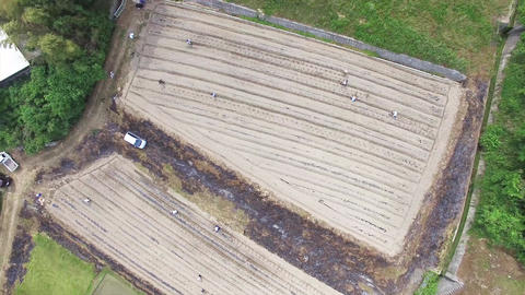 Aerial view while slowly rotating from above the field Footage