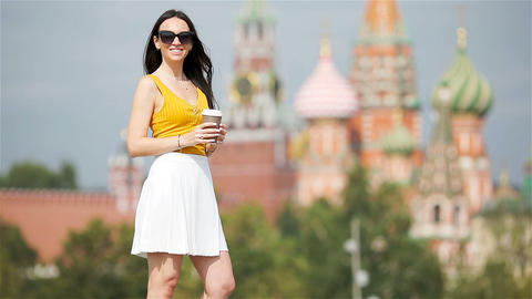 Happy young urban woman drinking coffee in european city Footage
