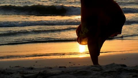 Young man practicing relaxation yoga exercises by the sea Live Action