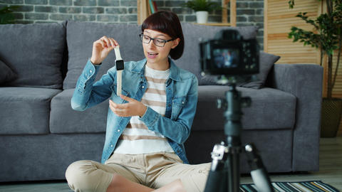 Slow motion of woman holding watch recording video about gadget speaking Live Action