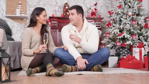 Caucasian couple having an intimate moment at Christmas eve Live Action