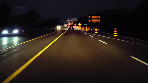 Driving Lane Ends Rural Road With Construction Marker Signs at Night. Driver Point of View POV Footage