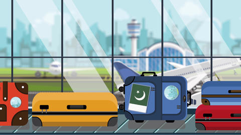 Baggage with Pakistani flag stickers on carousel in airport, close-up. Tourism Live Action