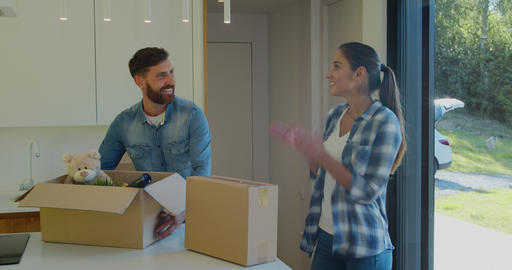 Couple Carrying Boxes Into New Home On Moving Day Footage