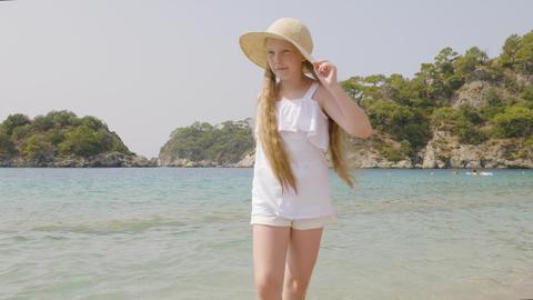 Playful teenager girl splashing transparent sea water on... Stock Video Footage
