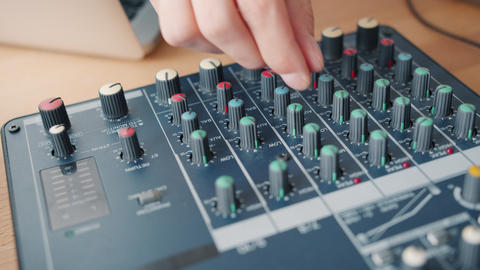 Close-up shot of male hand adjusting sound using modern audio equipment Footage