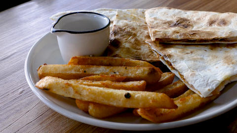 Sprinkle pepper fries quessidilla Stock Video Footage