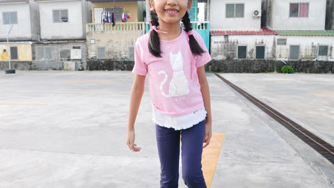 Little Asian girl playing skateboard with happiness GIF