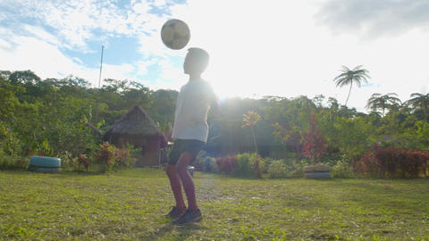 Young Indigenous Boy Plays Football Outside In His Native Village In Ecuador Footage