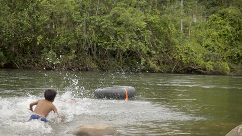 Indigenous Boys Are Playing In Water In Ecuador Live Action