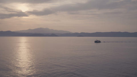 Scenic landscape of cruise ship slowly sailing through calm sea with cloudy sky Footage