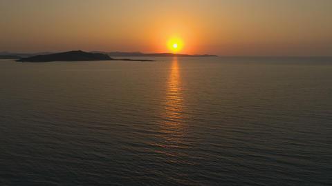 Big orange sun creating sun path in the sea surface Live Action